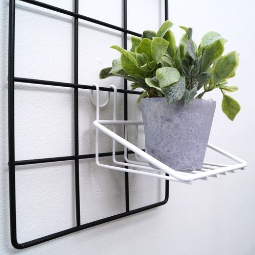 White small shelf in the wall grid